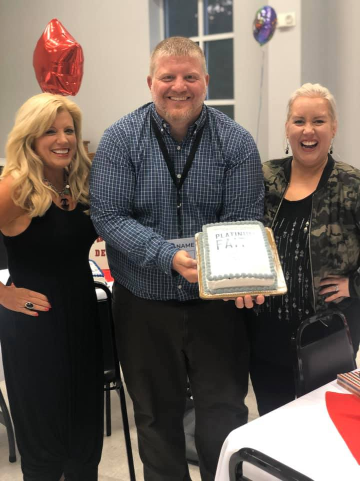 Michelle, Cyle, & Bethany with their Platinum Faith cake